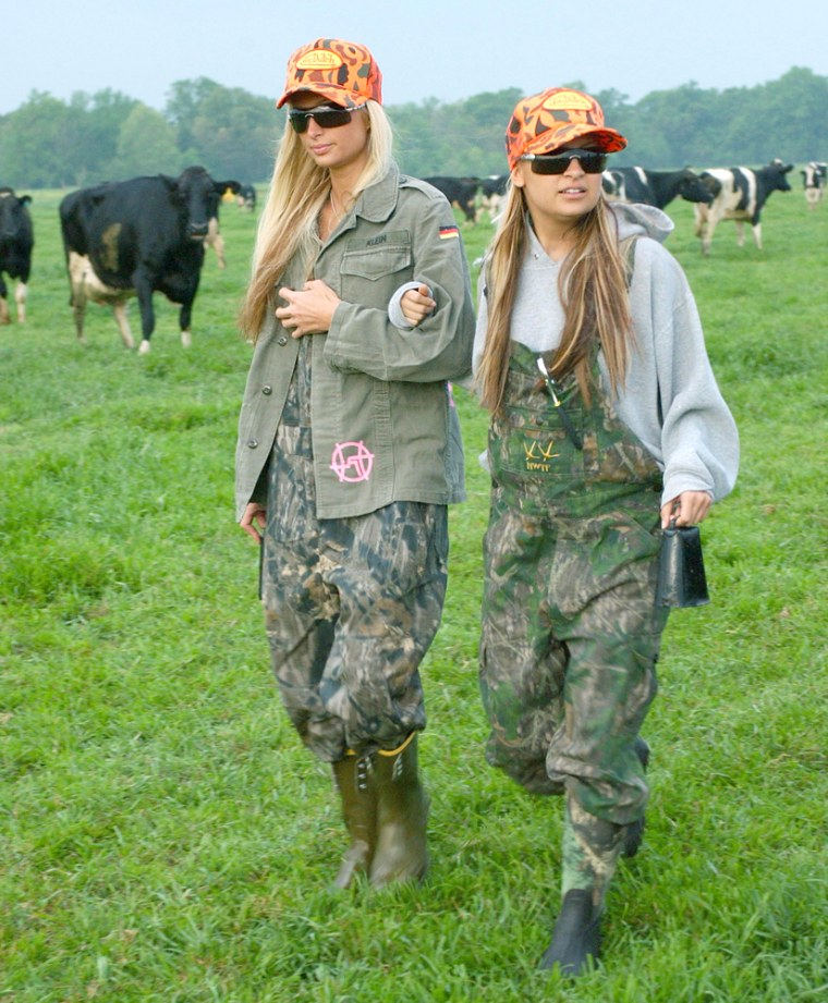 THE SIMPLE LIFE:  Paris Hilton (L) and Nicole Richie (R) work on a dairy farm in THE SIMPLE LIFE premiering Tuesday, December 2 (8:00-8:30 PM ET/PT) on FOX.   2003 FOX BROADCASTING COMPANY.  Cr:  Michael Yarish/FOX.