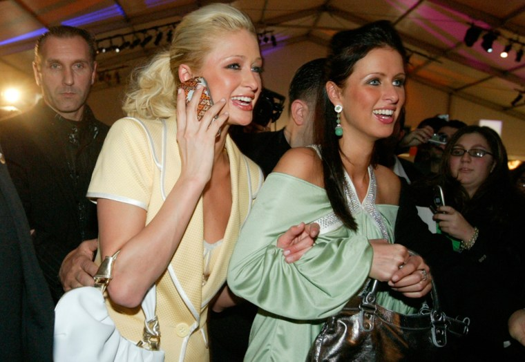 Paris Hilton, left, and her sister Nicky Hilton leave the Luca Luca Fall 2005 fashion show, Sunday, Feb. 6, 2005, in New York. (AP Photo/Diane Bondareff)