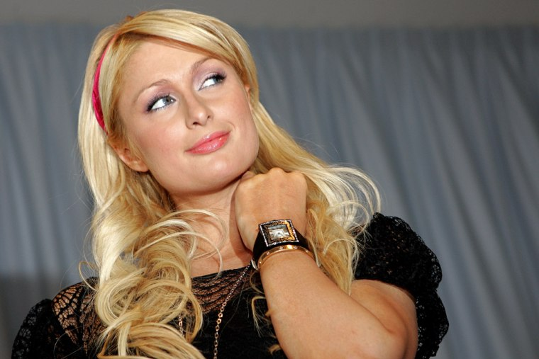 US celebrity socialite Paris Hilton pose
