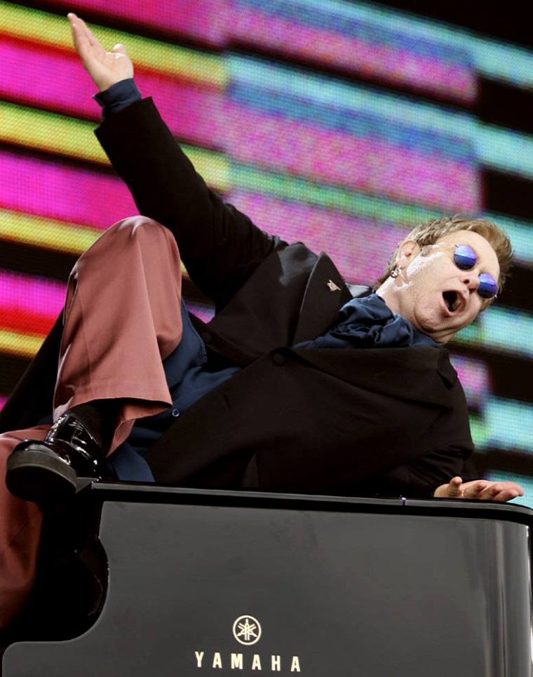 Elton John performs at the Live 8 concert in Hyde Park, London, Saturday July 2, 2005. The concert is part of a series of free concerts being held around the world  designed to press leaders of the rich G8 countries to help impoverished African nations. (AP Photo/Lefteris Pitarakis)