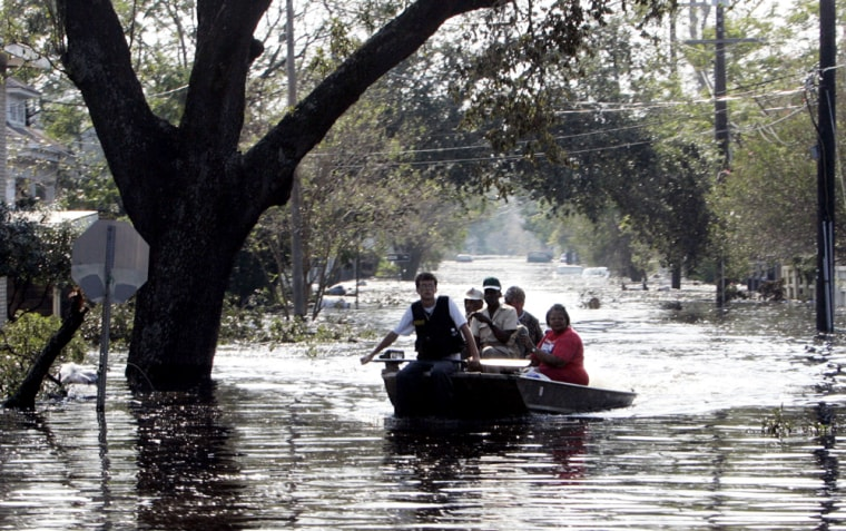 New Orleans residents are evacuated by boat on Wednesday. Thousands of residents who rode out Hurricane Katrina are now seeking a way out of the besieged city.