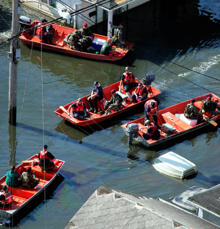 Search and rescue personnel go house to house on floodwaters of Hurricane Katrina in New Orleans