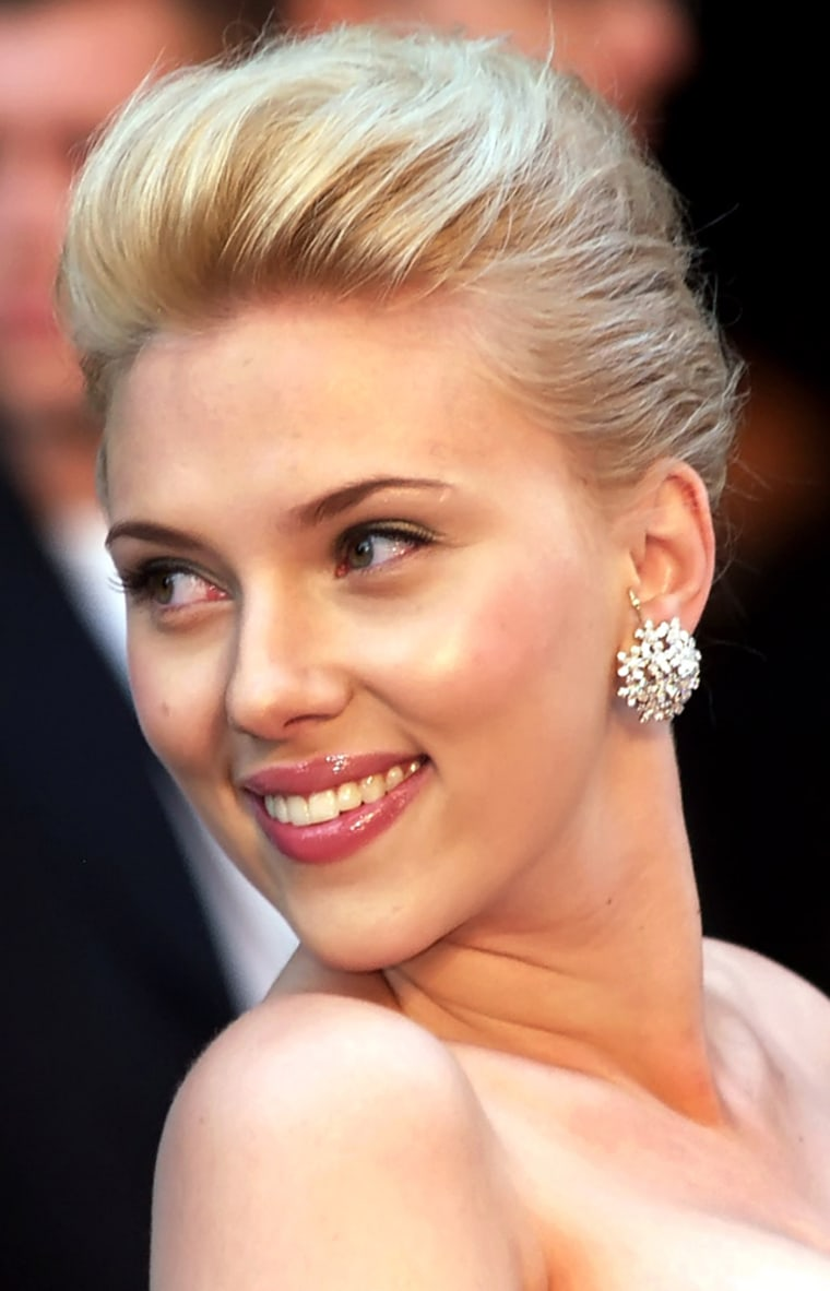 ** FILE ** ctress Scarlett Johansson arrives for the European Premiere of her film, The Island, in London, in this Sunday Aug. 7, 2005 file photo. Johansson is glad that Woody Allen emphasizes words, not action. (AP Photo/ Max Nash)