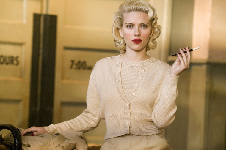 The mysterious Kay Lake (SCARLETT JOHANSSON)  The Black Dahlia is set in 1940s Los Angeles. Two cops, Bucky Bleichert (Josh Hartnett) and his partner, Lee Blanchard (Aaron Eckhart), investigate the death of Elizabeth Short, a young woman found brutally murdered. Bucky soon realizes that his girlfriend had ties to the deceased, and soon after that, he begins uncovering corruption and conspiracy within the police department.