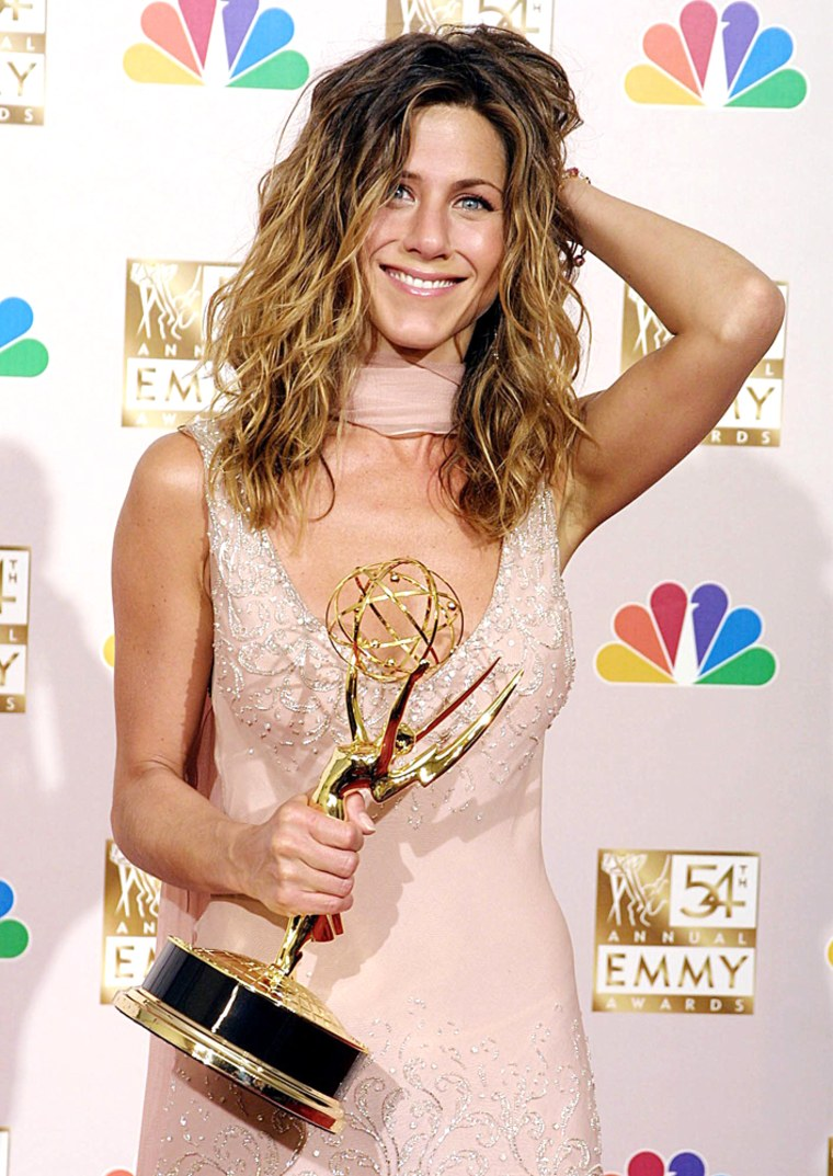 Jennifer Aniston holds her Emmy Award for Outstand