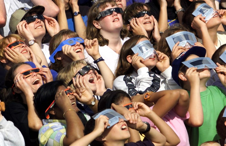 CHILDREN TRY OUT THEIR PROTECTIVE GLASSES FOR THE ECLIPSE