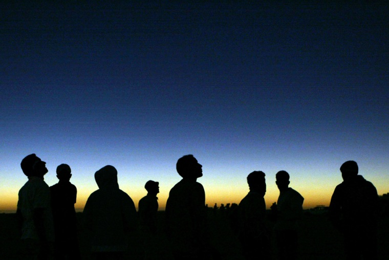 Libyan youths watch the solar eclipse in