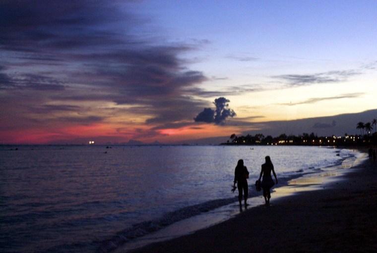 The sun sets on Waikiki, in Honolulu, Hawaii.