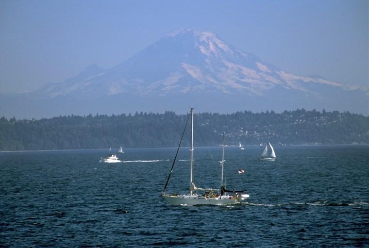 The majestic Mount Rainier watches over pleasure boats on Washington's Puget Sound.