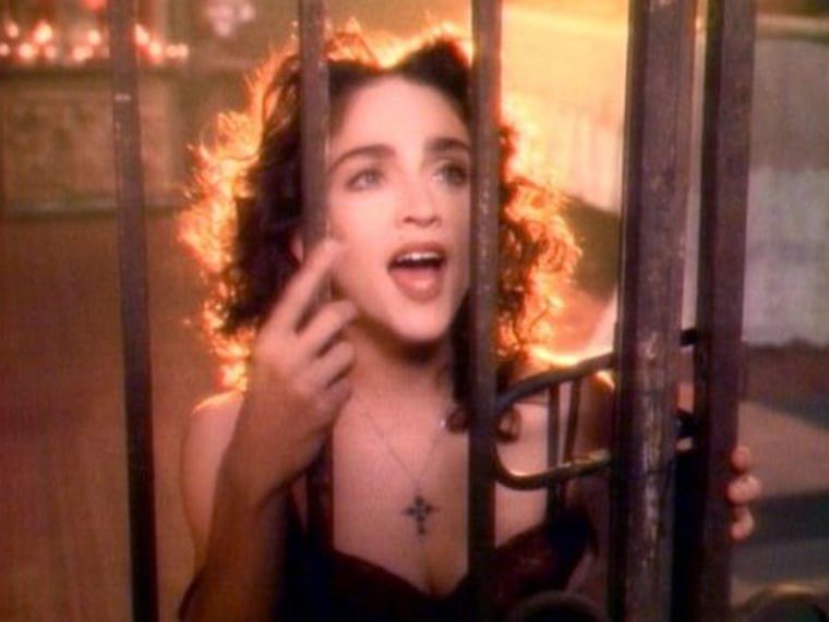 """Madonna in the 1998 music video for"""" Like a Prayer,"""" her fourth album. The album sparked new controversies due to the title track's video combination of religious and sexual imagery, including Madonna having sex with a black Jesus, burning crosses, and stigmata."""