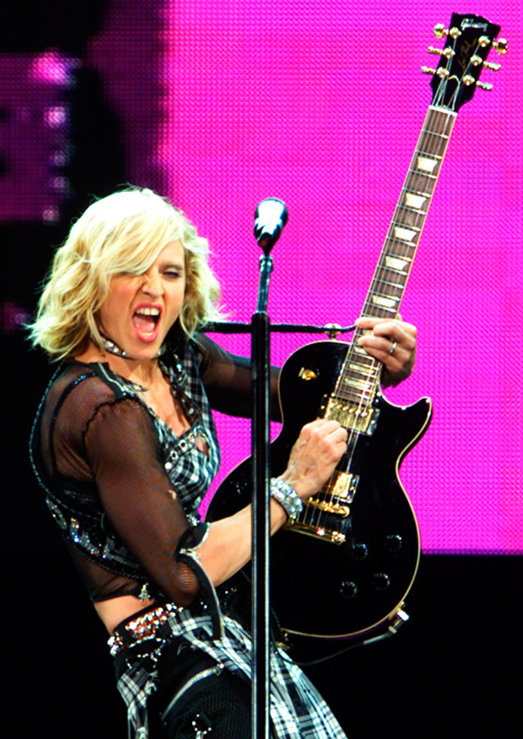 MADONNA JAMS ON A GUITAR DURING DROWNED WORLD TOUR PERFORMANCE IN  FLORIDA.