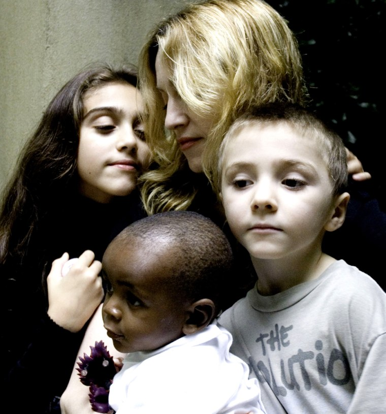 """In this undated handout photo provided by Madonna's publicist Liz Rosenberg, Madonna is shown with her daughter Lourdes, 9, left, son Rocco, 6, right and David Banda, 13-months, who she plans to adopt with her husband director Guy Ritchie. Madonna said that David is healthy and thriving in her London home, in an interview that aired Wednesday, Oct. 25, 2006, on """"The Oprah Winfrey Show."""" The child was taken to London last week after Malawi's High Court granted Madonna and her husband, director Guy Ritchie, an interim adoption order. (AP Photo/Shavawn Rissman) ** NO SALES **"""