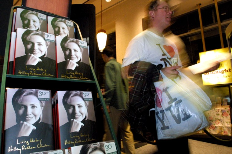 "Richard Fullam, of Boston Mass., passes by a display of Hillary Rodham Clinton's new book ""Living History"" at a Barnes and Noble in New York after purchasing the book shortly after midnight Monday June 9, 2003. (AP Photo/Tina Fineberg)"