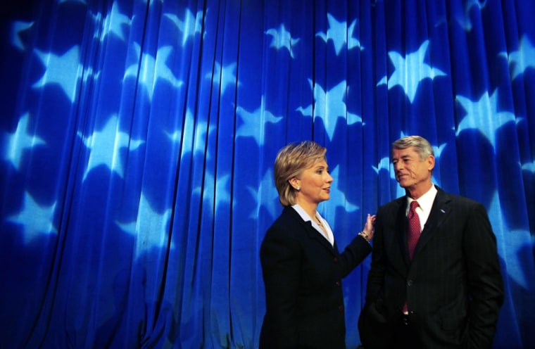 U.S. Senator Hillary Rodham Clinton greets her Republican challenger John Spencer at the start of their debate in New York