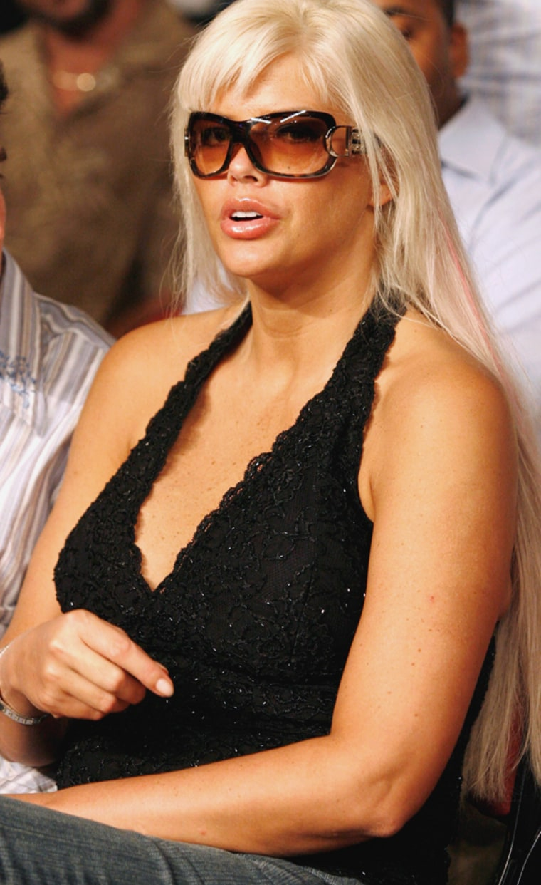 Anna Nicole Smith watches a boxing match from the ringside at the Seminole Hard Rock Hotel and Casino in Hollywood