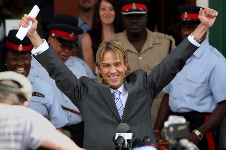 Larry Birkhead smiles and raises his hands in the air after a paternity hearing the Bahamian court, in Nassau, Bahamas, Tuesday, April 10, 2007. DNA analysis released during the hearing has proven that Anna Nicole Smith's former boyfriend Larry Birkhead is the father of her infant daughter, an expert in genetic evidence said Tuesday. (AP Photo/Christine Aylen)