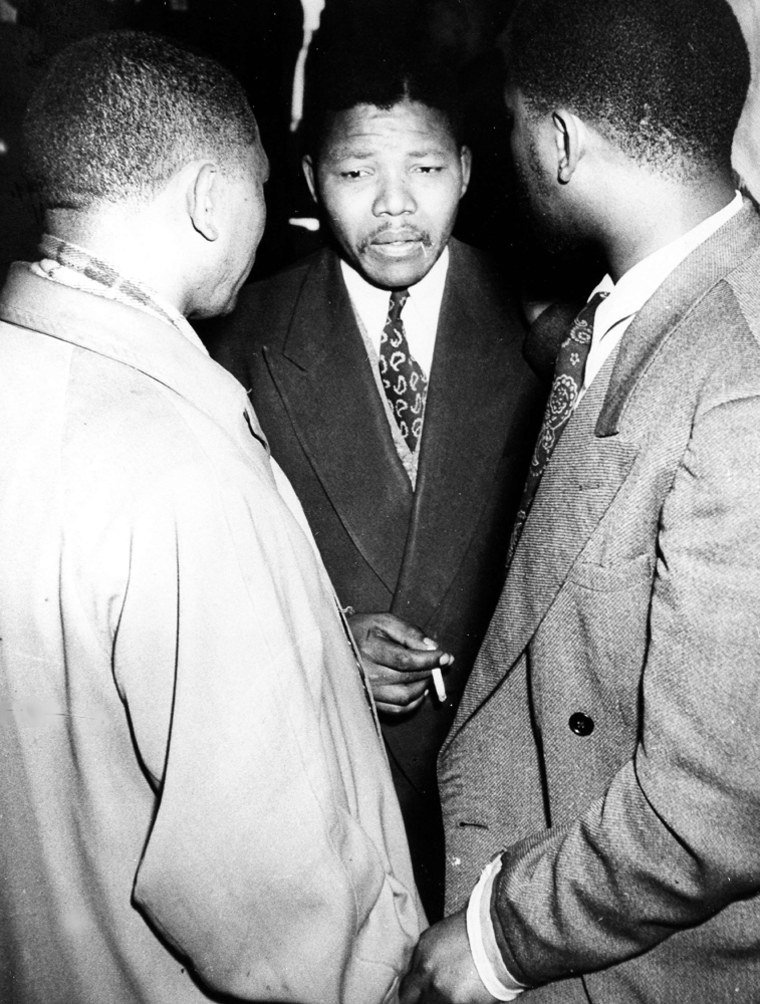 South African ANC Youth League leaders, Nelson Mandela, centre, Walter Sisulu, left, and Harrison Motlana, during the Defiance Campaign trial at the Supreme Court, in Johannesburg, in 1952. The Defiance Campaign encouraged people to defy the apartheid laws. (AP Photo/Schadeberg) MANDATORY CREDIT