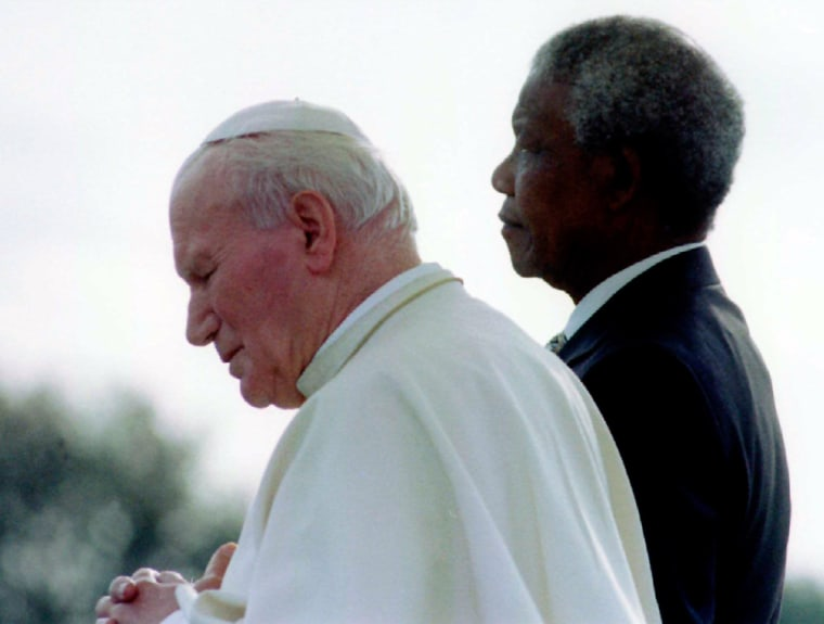 Mandela and Pope listen to national anthems at Johannesburg Airport.