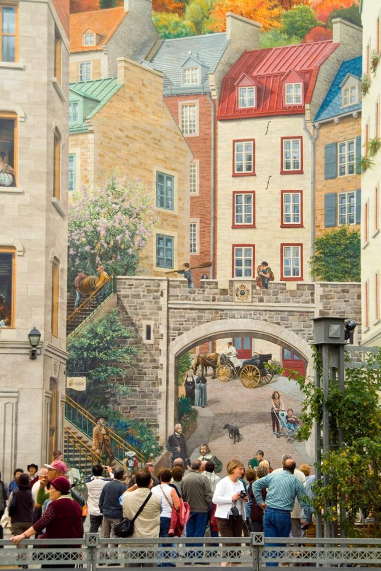 Tourists Beneath Fresque des Quebecois Mural