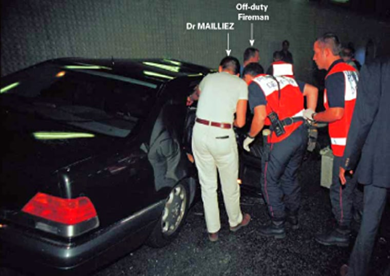 A handout image obtained in London, 03 October 2007, from the coroner Lord Justice Scott Baker, shows emergency services personnel attending to the wreckage of the Mercedes carrying Diana, Princess of Wales and Dodi Al Fayed in a Paris underpass in August 1997. Eleven jurors were selected Tuesday 02 October 2007, to decide if there is any truth to claims that Britain's royal family ordered the murder of Princess Diana, as a formal inquest into her death in 1997 finally opened. AFP PHOTO/ARNAL/SCOTT BAKER INQUEST   **** RESTRICTED FOR EDITORIAL USE **** NO SALES **** (Photo credit should read ARNAL/SCOTT BAKER INQUEST/AFP/Getty Images)