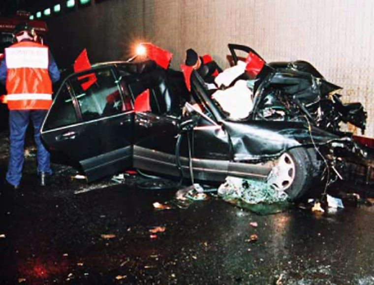 A handout image obtained in London, 03 October 2007, from the coroner Lord Justice Scott Baker, shows emergency services personnel attending to the wreckage of the Mercedes carrying Diana, Princess of Wales and Dodi Al Fayed in a Paris underpass in August 1997. Eleven jurors were selected Tuesday 02 October 2007, to decide if there is any truth to claims that Britain's royal family ordered the murder of Princess Diana, as a formal inquest into her death in 1997 finally opened. AFP PHOTO/EMERGENCY SERVICES/SCOTT BAKER INQUEST   **** RESTRICTED FOR EDITORIAL USE **** NO SALES **** (Photo credit should read EMERGENCY SERVICES/SCOTT BAKER I/AFP/Getty Images)