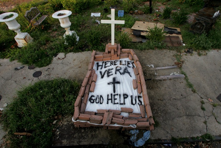 A makeshift tomb at a New Orleans street corner conceals a body that had been lying on the sidewalk for days in the wake of Hurricane Katrina on Sunday, Sept. 4, 2005. (AP Photo/Dave Martin)