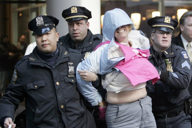 Peace activist Sheehan is arrested by police officers after blocking door to US Mission offices in New York