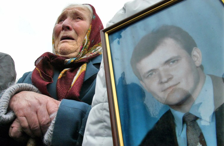 Ukrainian woman cries during memorial demonstration dedicated to Chernobyl liquidators who died after nuclear disaster