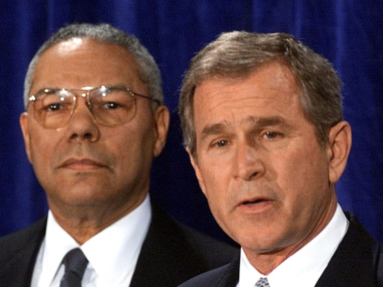 Image: US President-elect George W. Bush (R) announces his nomination of retired General Colin Powell (L) as Secretary of State