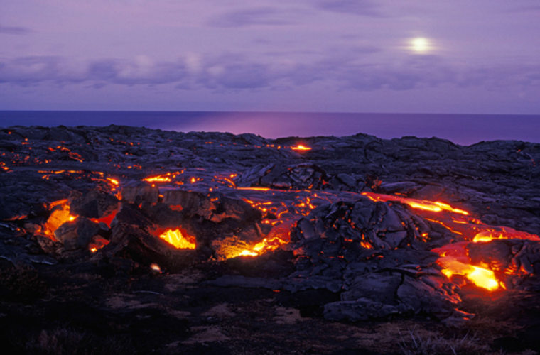 Inside the cones of volcanoes on Hawaii's Big Island, scientists have actually measured zero sound levels. But that's on a windless day when no helicopters are flying. Instead, head to the Holei Sea Arch and go inland across the old lava. Listen to the earth form itself anew in hisses and cracks.
