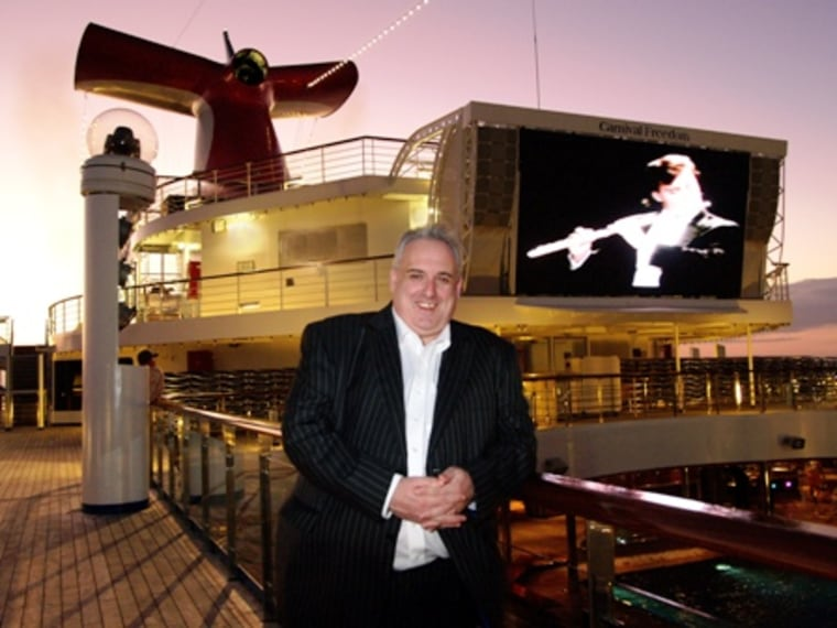 "John Heald, Carnival Cruise Lines' senior cruise director, has become the most famous cruise director since Julie McCoy of ""Love Boat"" TV fame. Except John's not on TV. His blog, boasting thousands of readers, has changed the way cruise lines interact with their customers by building online communities."