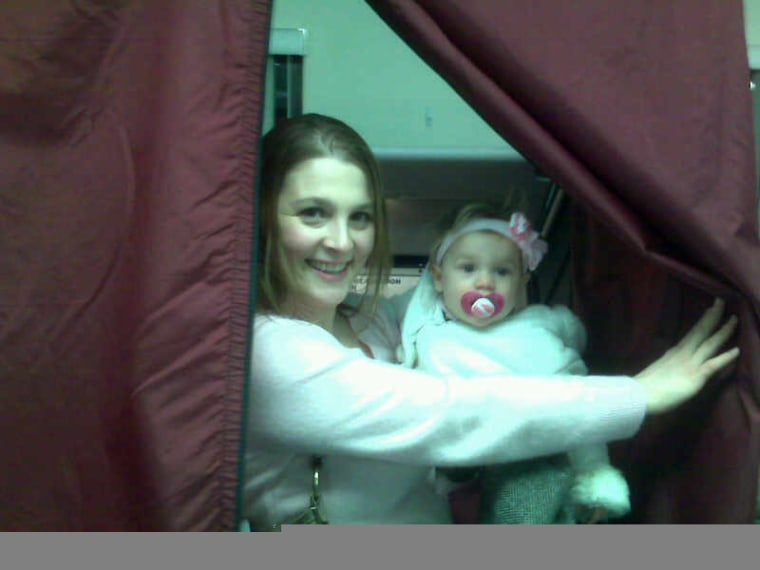 """User Diana Rosenthal submitted this photo and wrote: """"Nine-month-old Julianna James goes into voting booth with Mom to make history and vote for the first women president."""""""