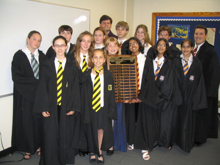 This is a picture of the Defense Against the Dark Arts club. That's me with shsort hair on the far right.