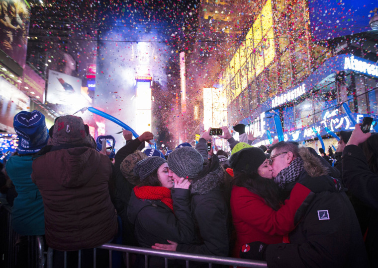 Miranda Echerarria and Christian Prieto, of Niagra, N.Y. kiss at the stroke of midnight during the New Year's Eve celebrations in Times Square, Wednesday, Jan. 1, 2014, in New York. (AP Photo/John Minchillo)