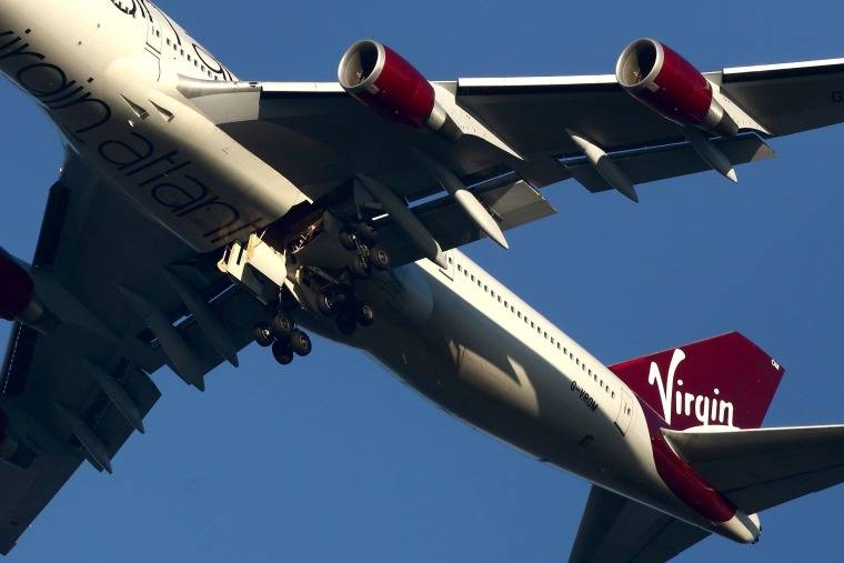 The suspected Virgin Atlantic Boeing 747 jumbo jet passenger plane hovers in the sky as it reportedly prepares for a non-standard landing at Gatwick airport in West Sussex on Monday.