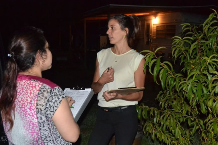 Amy Schmidt, executive director of Vecinos in Cullowhee, North Carolina, speaking with volunteer Maria Vargas Ruiz as they brought medical assistance to recent immigrants.
