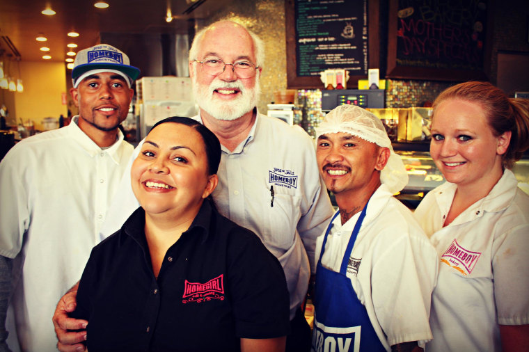 Father Greg Boyle and some of the many people his Los Angeles-based Homeboy Industries has helped through job and skills training.