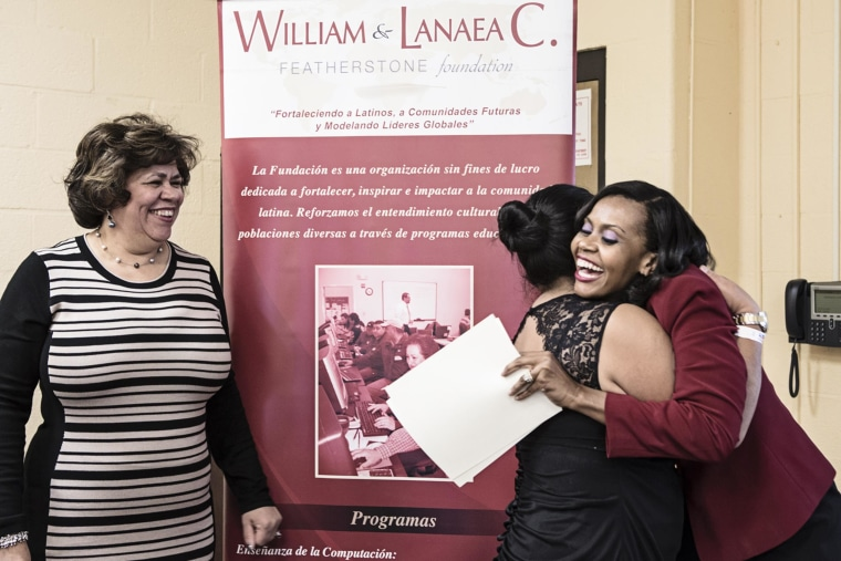 Lanaea Featherstone, shown on right, co-founder of Baltimore, Maryland's Featherstone Foundation, hugging one of the participants in its computer literacy programs.
