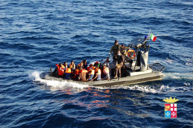 Image: Immigrants being rescued by the Italian Navy near the island of Lampedusa