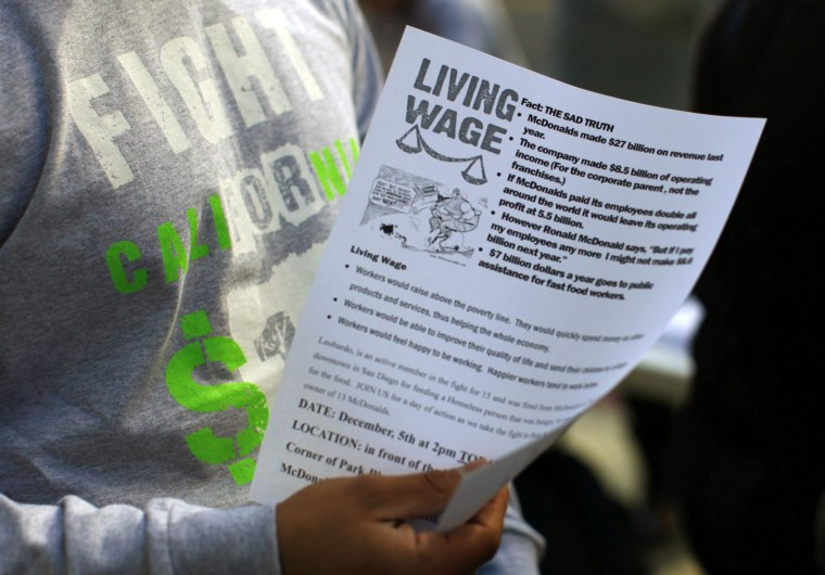 Protesters pass out information sheets outside a Wendy's fast food outlet in support of a nationwide strike and protest at fast food restaurants to raise the minimum hourly wage to $15.