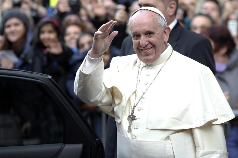 Image: Pope Francis waves as he leaves at the end of his mass at the Church of the Most Holy Name of Jesus in downtown Rome