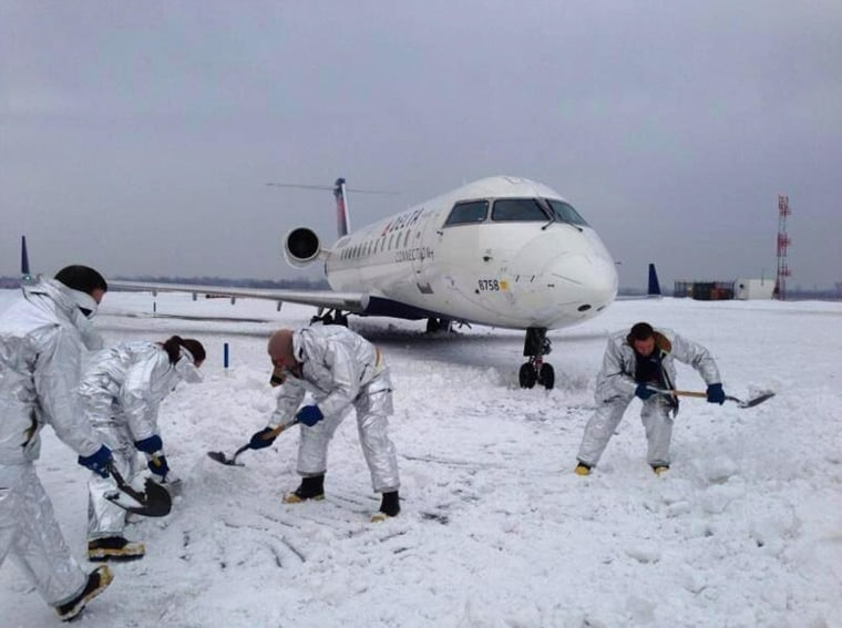 Image: The plane skidded into a snowbank after landing at JFK.