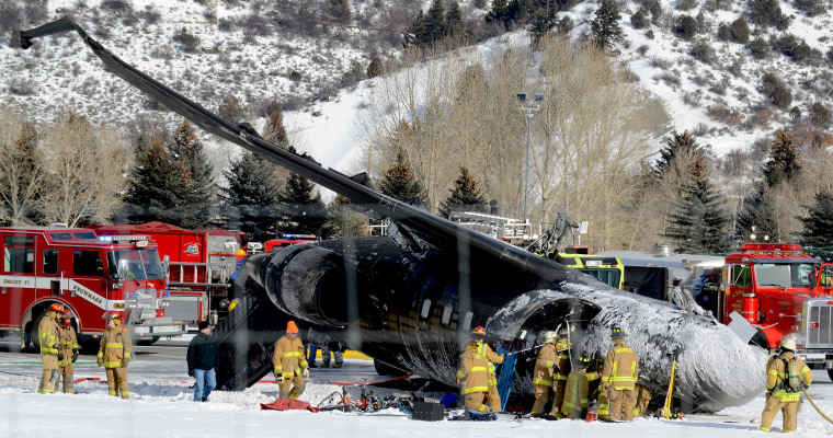 Image: Emergency crews work near a passenger plane that crashed upon landing at an Aspen, Colo., airport.