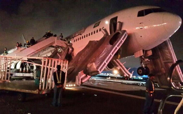 Image: A plane is pictured after an emergency landing at Medina airport