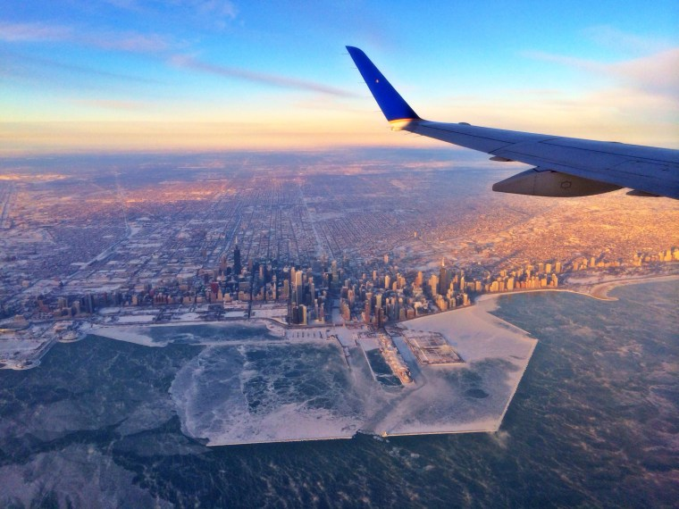 """Pilot Hank Cain captured this image of a frozen Chicago from an United Express flight from Washington D.C. to the Windy City. Chicago felt like 31 below this morning as artic air from a """"polar vortex"""" locked nearly the entire United States under subfreezing temperatures Tuesday. Follow Cain on Instagram at @flyhankcain."""