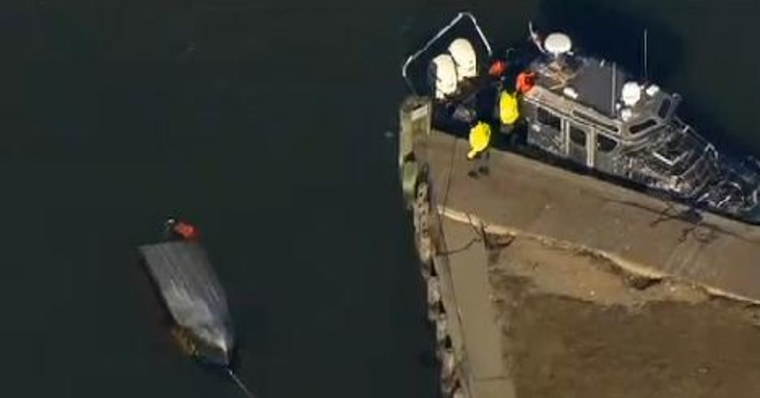 Capsized fishing boat off the shore of Westport, Mass., on Jan. 7, 2014.