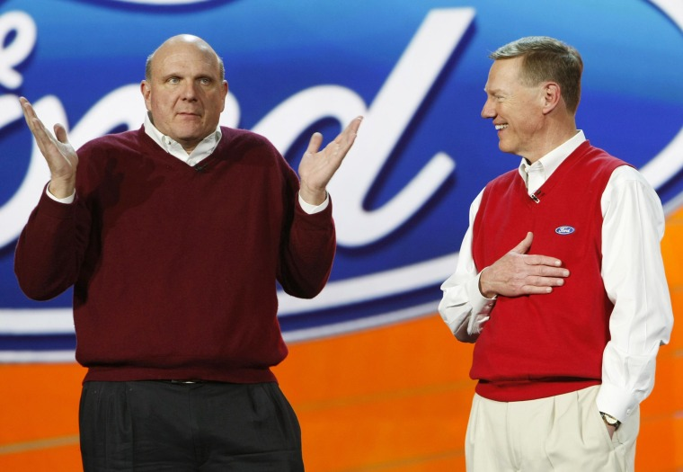 Ford Motor Co. President and CEO Alan Mulally listens to Microsoft CEO Steve Ballmer.
