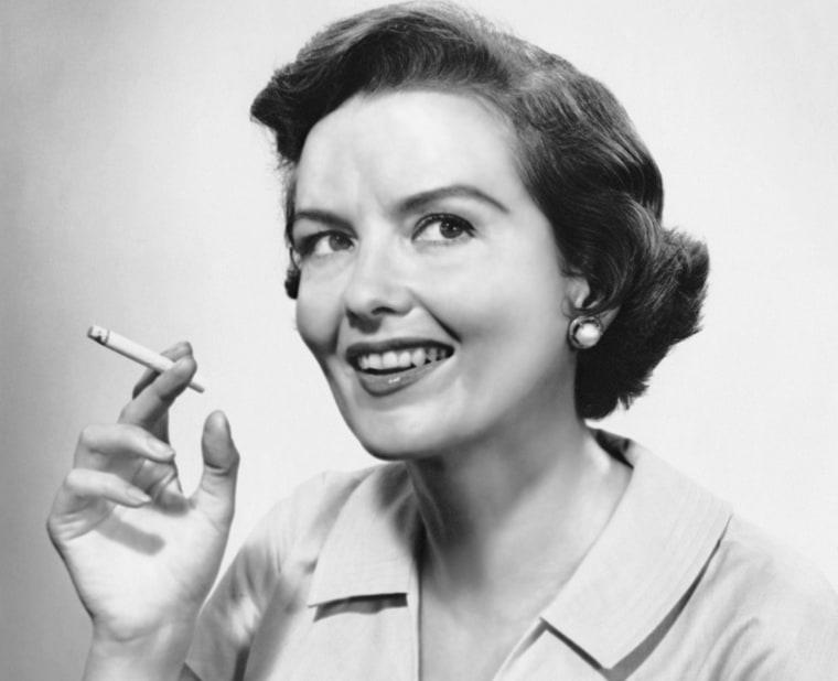 Image: Portrait of woman holding cigarettte
