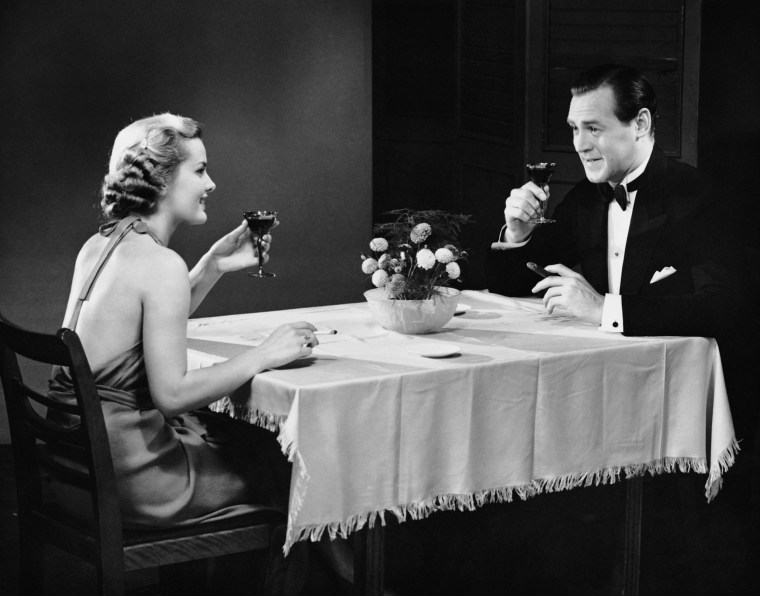 Couple talking over drinks