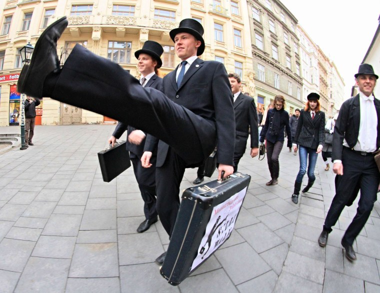 Image: Supporters of British comedy group Monty Python perform their skills during the International Silly Walk Day